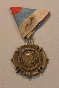 Druhá medaile po restaurování
