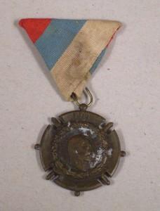 Druhá medaile před restaurováním