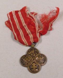První medaile před restaurováním